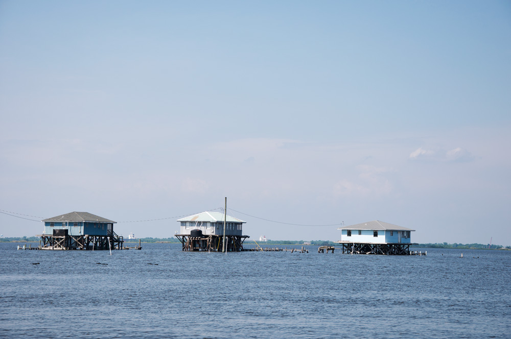 Coastal Louisiana scene: fishing camps built over the water