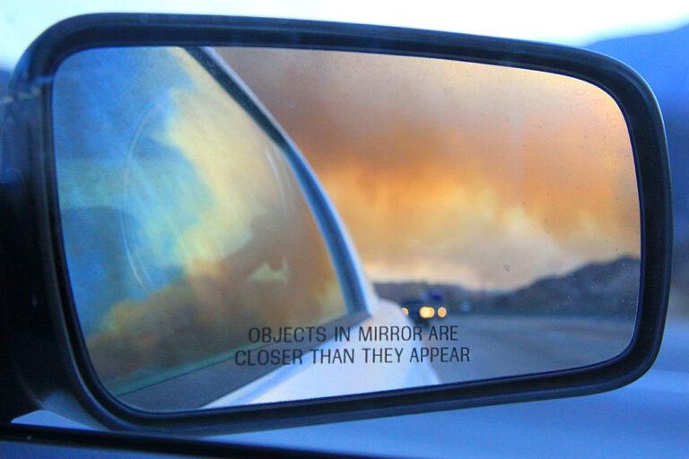 Wildfire in car mirror